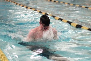 Woodland's Don White does the breaststroke during the 200 medley relay versus Holy Cross Feb. 9 in Beacon Falls. –ELIO GUGLIOTTI