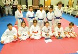 Students from USA Martial Arts in Naugatuck were promoted following a junior beginners grading Feb. 25. Pictured, front row, Bradley Barnes (apprentice orange), Alanna Pace (orange), Ana Sales, Jarok Dauber, Jaiden Dozier and Sazon Cermenika (blue belt); back row, Xavier Blanchet, Arelys Robles, Bradley Minchala (apprentice purple), Iaasac Silva (purple) and Luke Reilly (apprentice green). –CONTRIBUTED
