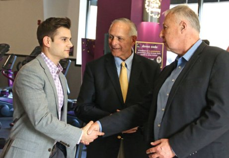 Joe Pepe, president of the Connecticut Planet Fitness chains, left, shakes hands with Naugatuck Mayor N. Warren 'Pete' Hess as the two talk with Naugatuck Economic Development Corporation President and CEO Ron Pugliese, center, during a ribbon cutting ceremony March 16 to celebrate the grand opening of the new Planet Fitness on New Haven Road. Planet Fitness, which has been operating in Naugatuck since 2005, built a new facility on property behind its former gym. –LUKE MARSHALL