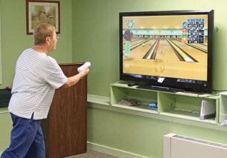 Leslie Kingston, of Prospect, tries to pick up a spare while playing Nintendo Wii bowling at the Prospect Senior Center Feb. 29. Seniors meet on Mondays and Wednesdays at the center to participate in the center's Wii Bowling League. –LUKE MARSHALL