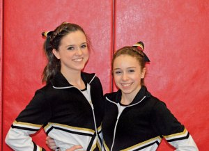 Woodland freshmen and twin sisters Stephanie, left, and Kristina Poynton recently concluded their first varsity season of gymnastics representing the Hawks. –KEN MORSE