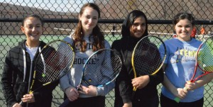 Woodland seniors, from left, Alexandra Pettas, Paige Gainey, Rayhan Luzeri and Katie Rioux will lead the Hawks this season as they seek to make it to the NVL tennis championship for the fourth straight year. –KEN MORSE