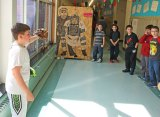 Cross Street Intermediate School fifth-grader Nathaniel Parker shows off his invention, the Practice Target 2000, to his peers March 31 during the school's Invention Convention. –LUKE MARSHALL