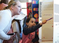 Prospect Elementary third-grader Ava Morello discusses her science experiment on which nail polish lasts the longest with Ginny Ligi, of Prospect, during the 21st annual Science Fair at the school April 15. –ELIO GUGLIOTTI