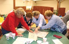 From left, former Beacon Falls First Selectman Susan Cable, Beacon Falls Tax Collector Mary Anne Holloway, Nancy Betkoski and Pat Caldwell put words together during the Friends of the Beacon Falls Library's annual Letters for Our Library Scrabble Challenge fundraiser March 31 at St. Michael's Lyceum. Rather than playing against each other, the challenge featured teams of players putting together words for the highest possible score across the board. –LUKE MARSHALL