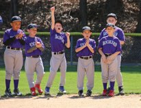 Members of Robert A. Cole Little League Rockies cheer when their team is announced April 16 during the Little League's opening day ceremony at the Pent Road Recreation Complex in Beacon Falls. –LUKE MARSHALL