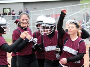 Naugatuck's Jackie Aronin (6) is congratulated by her teammates at home plate after hitting a leadoff homerun Monday versus Wolcott in Naugatuck. Naugatuck won the game, 7-6. –ELIO GUGLIOTTI