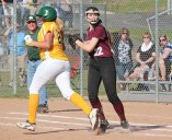Naugatuck's Olivia Rotatori (22) looks to home plate after tagging out Holy Cross' Nicole Strielkauskas (27) Monday in Naugatuck. Holy Cross won the game, 3-0. –ELIO GUGLIOTTI