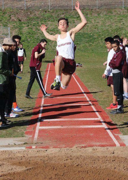 Naugatuck's Benjamin Healy competes in the long jump April 12 during a quad-meet against Waterbury Career, Torrington and Wilby in Naugatuck. Through two meets, the Naugatuck boys and girls teams are 5-1. –LUKE MARSHALL