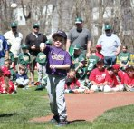 Michael Warobel, representing the Peter J. Foley Little League T-ball division, throws out a first pitch during the Little League's opening day ceremony April 17 in Naugatuck. –ELIO GUGLIOTTI