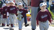 Members of the Union City Little League Little Tykes march onto the field during the Little League's opening day ceremony April 16 in Naugatuck. –KEN MORSE
