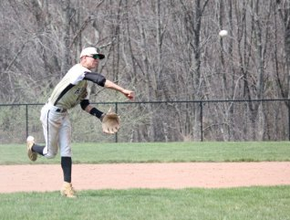 Woodland's Tyler Boisvert throws to first for an out April 22 versus Ansonia in Beacon Falls. –ELIO GUGLIOTTI