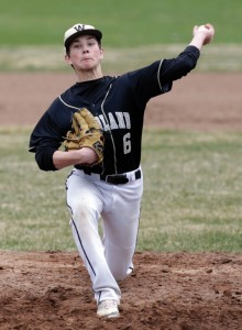 Woodland's Brett Petruny delivers a pitch Saturday against Torrington at Fuessenich Park. Torrington won the game, 4-1. -REPUBLICAN-AMERICAN