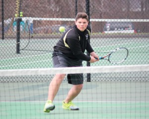 Woodland's Mike Roulanaitis lines up a backhand during his match with Naugatuck's Jonas Mauermann April 8 in Beacon Falls. –ELIO GUGLIOTTI