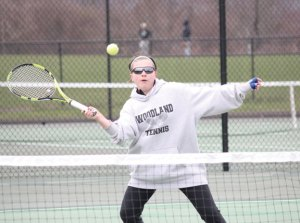 Woodland's Amanda Doughney attacks the ball at the net during her match versus St. Paul April 6 in Beacon Falls. –ELIO GUGLIOTTI