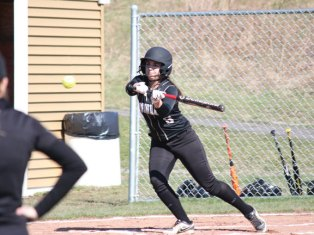 Woodland's Ivy Geloso lays down a bunt April 13 versus Wilby in Beacon Falls. Woodland won the game, 21-2. -ELIO GUGLIOTTI