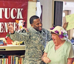 U.S. Army Sgt. Korean Treadwell, left, celebrates as he moves even with June Ottowell in a 'horse' race during the Naugatuck Senior Center's annual Kentucky Derby Day May 6. The event featured races in which members of the center and volunteers acted as 'horses' and moved closer to the finish line with a roll of the dice. –ELIO GUGLIOTTI