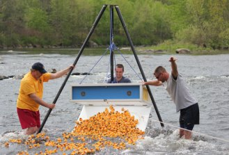 From left, Beacon Falls Lion Club member Mike Krenesky, Adam Daniels and Jeff Kean, both members of Beacon Hose Company No. 1, watch after hundreds of rubber ducks are released into the Naugatuck River during the 18th annual Beacon Falls River Festival and Duck Race in Beacon Falls last year.