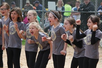 Members of the Prospect-Beacon Falls Softball Little League's Woodland Warriors cheer when their team is announced during the league's opening day ceremony April 23 at the Pent Road Recreation Complex in Beacon Falls. –ELIO GUGLIOTTI