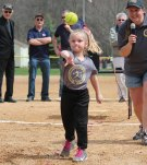 Mia Geci, of the Prospect-Beacon Falls Softball Little League's Lady Huskies, throws out the first pitch during the league's opening day ceremony April 23 at the Pent Road Recreation Complex in Beacon Falls. –ELIO GUGLIOTTI