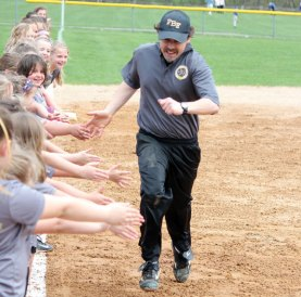Jeff Fencil, of the Prospect-Beacon Falls Softball Little League, gets players pumped up before the league's opening day ceremony April 23 at the Pent Road Recreation Complex in Beacon Falls. –ELIO GUGLIOTTI