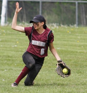 Naugatuck's Jackie Aronin makes a sliding catch against Torrington during the quarterfinals of the NVL tournament Saturday in Torrington. –REPUBLICAN-AMERICAN