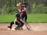 Naugatuck's Mckenzi Staples (11) throws to first after getting the force out at second base on Woodland's Emily Brouillette (5) Monday in Beacon Falls. Naugatuck won the game, 5-1. –ELIO GUGLIOTTI