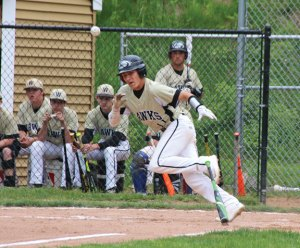 Woodland's Matthew Butterworth (11) heads towards first after laying down a bunt against Torrington Tuesday in Beacon Falls. Woodland won the game, 12-4. -LUKE MARSHALL