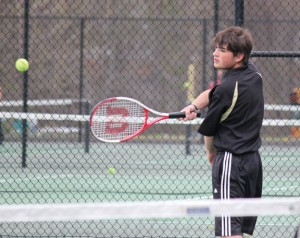 Woodland's Nick Lucas returns a shot versus Wolcott April 29 in Beacon Falls. Wolcott won the match, 8-1.