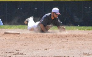 Post 17 shortstop Steve Marinaro makes a diving attempt at a ball through the infield versus Danbury Saturday in Naugatuck. Danbury won the game, 5-4. –KEN MORSE