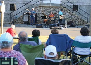 People gather on the Prospect Town Green June 29 to listen to Joe Neumann and the Big Beat perform during the town's summer concert series. The concert series features a new band every Wednesday from 7 to 8:30 p.m. on the Green through Aug. 24. –LUKE MARSHALL