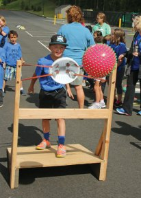 Prospect Elementary School first-grader Evan Mastropietro shoots a ball while playing the school's version of Angry Birds during Field Day at Prospect Elementary School June 9. –LUKE MARSHALL