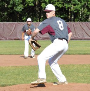 Post 17's Matt Whitney delivers a pitch versus Oakville June 29 at Pomperaug High School. Oakville won the game, 5-4. –KEN MORSE
