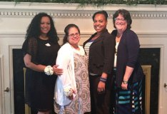 Staff members from Beacon Brook Health Center in Naugatuck, from left, Marlene Rodrigues, Yanira Rosado and Sharena Kidd, were recently honored at Athena Healthcare's Partners in Dedication luncheon for ten years of service. They are pictured with administrator Linda Garcia. –CONTRIBUTED
