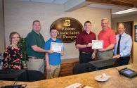 Woodland Regional High School graduates Michael Tuohy and Zachary Crowell were the recipients of The Prospect Business Association's inaugural scholarships. They were presented with $1,000 scholarships at a business after hours event Aug. 11 hosted by Vision Associates in Prospect. Tuohy and Crowell will continue their educations this fall at Central Connecticut State University and Northeastern University, respectively. Going forward, the PBA will be awarding two such scholarships on an annual basis. Pictured, from left, Dr. Catherine M. Gelinas of Vision Associates, PBA President Matt Buonaiuto, Tuohy, Crowell, PBA Treasurer Jeff Holley and Vision Associates owner Dr. Lawrence N. Kline. –CONTRIBUTED