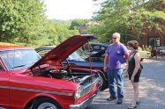 Naugatuck residents George Furphy and Jessie Furphy check out a Chevy Nova July 21 during a Car Cruise at Beacon Brook Health Center in Naugatuck. The event featured vintage cars and raised money for Rose Hope Animal Refuge, a Waterbury-based nonprofit organization that helps finds homes for animals. –LUKE MARSHALL