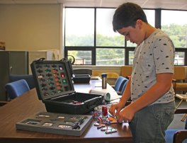 Skyler Pawlowski, 13, of Naugatuck builds a circuit that activates an alarm on Aug. 11 during the Explore Circuits program at the Beacon Falls Library. The program is part of the library's initiative to bring more science, technology, engineering, and mathematic programs to the community. –LUKE MARSHALL