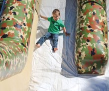 Josiah Peragalo, 4, of Prospect slides down an inflatable slide Aug. 23 during Prospect's annual End of Summer Fun Week on the Town Green. –LUKE MARSHALL