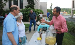 Sunny Rajvansh, right, of alcohol distributor Slocum and Sons, Inc., shows a bottle of High West Whiskey to Pete and Joy Pagliaro of Milford July 29 the Whittemore Library in Naugatuck July 29 as part of the library's second annual Happy Hour. The event featured live music and drinks provided by Fine Wine and Liquors. –LUKE MARSHALL