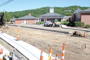 Work continued on the reconstruction of Highland Avenue in Beacon Falls on Monday. The portion of the road in front of Laurel Ledge Elementary School is expected to be passable by the time school starts next week. –ELIO GUGLIOTTI