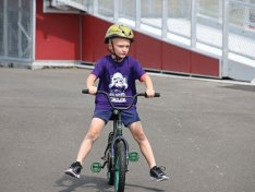 Naugatuck YMCA member Jayson Baltrush, 6, of Watertown, rides a bicycle July 28 at Naugatuck High School as part of a six-week training program to get ready for the YMCA Race4Chase Triathlon. The triathlon, which is Aug. 6 at YMCA Camp Sloper in Southington, is funded by the Chase Michael Anthony Kowalski Foundation. The foundation was set up in memory of Kowalski, a young triathlete who was killed in the Sandy Hook Elementary School shooting in 2012. The triathlon is open to children ages 6 to 13 that are members of one of 14 YMCAs across the state. The triathlon will feature a 1.25 mile bike ride, a 1 mile run, and a 100 meter swim. –LUKE MARSHALL