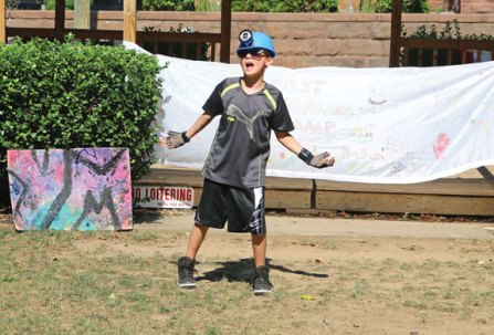 Jesse James Merrill, 9, of Beacon Falls, performs a dance routine to a version of DJ Snake and Lil Jon's 'Turn Down For What' July 22 on the Naugatuck Green during the Naugatuck YMCA's Summer Camp Talent Show. –LUKE MARSHALL