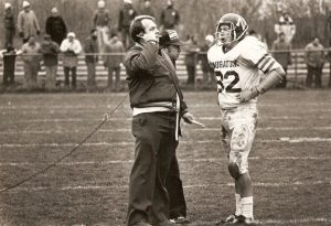 Former Naugatuck head football coach Craig Peters talks with John Lynn (82) during the state title game in 1981. The Greyhounds beat Xavier, 28-6, in the game to win their first state title. -NAUGATUCK HIGH SCHOOL FOOTBALL ALUMNI ASSOCIATION