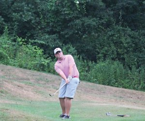 Mike Erickson pitches onto the first green during the Hop Brook Golf Course Men's Club Championship final Sunday versus Todd Gronau in Naugatuck. Erickson won the championship. –ELIO GUGLIOTTI