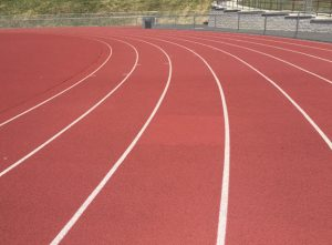 The portion of the Naugatuck High School track shown here in the middle is lighter in color and has a different texture than the rest of the track. It was damaged by a tractor-trailer driver two years ago and now Naugatuck officials want it fixed properly. –REPUBLICAN-AMERICAN
