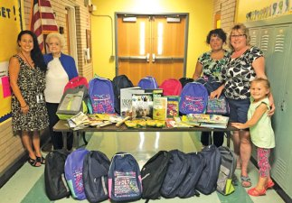 The Naugatuck Emblem Club recently donated backpacks filled with school supplies and books to Western School. The club has adopted the school for its community service projects for the year. Pictured, Principal Brenda Goodrich, Literacy Chairman Evelyn Brown, Club President Kim Best, Community Service Chairman Wendy Meagher and Jaylin Meagher, who helped fill the backpacks. –CONTRIBUTED