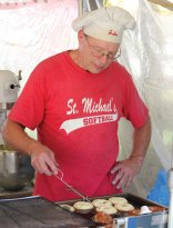 Volunteer John Rivers makes donuts Sept. 9 during the 57th Annual Village Green Fair hosted by St. Michael's Church on the Naugatuck Green. The annual fair featured music, children's activities, food and household items for sale. –ELIO GUGLIOTTI