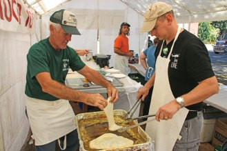 Bryan Curtis, left, and Jim Ruddy, both of Boy Scout Troop 102, prepare fried dough during the Harvest Moon Festival on the Naugatuck Town Green on Sept. 17. –LUKE MARSHALL