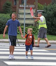 The new school year started Aug. 25 in Naugatuck and Region 16. Salem Elementary School first-grader Nathan Brouillet, 6, crosses Meadow Street with his father, Ian Russell, on the first day of school in Naugatuck. –LUKE MARSHALL
