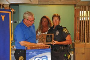 Beacon Falls police Officer Caroline O'Bar, right, receives the Beacon Falls Rotary Club's Service Above Self award from past club President Joe Dowdell, left, and President Karen Ambari Longo, center, Aug. 29 at The River's Edge Pub & Grille. –LUKE MARSHALL